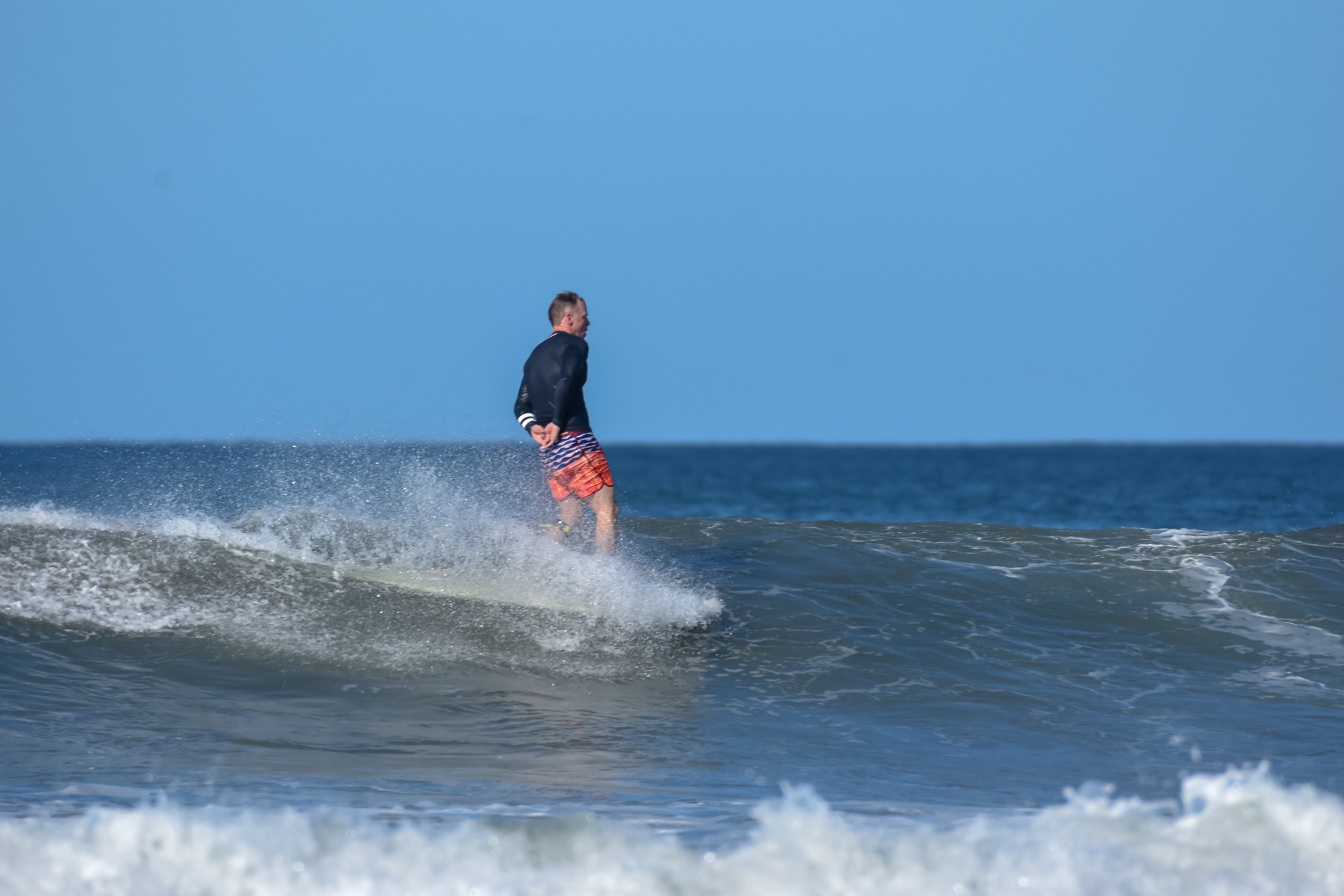 relaxed surfing in nosara costa rica