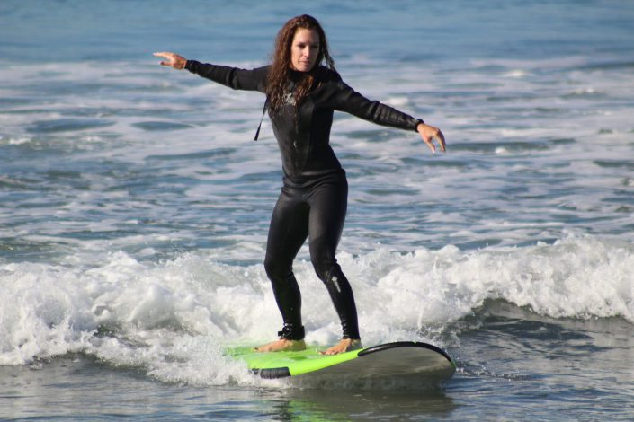 women surfing in huntington beach