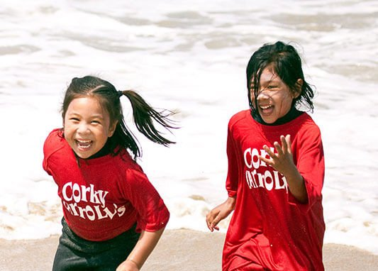 Girls Running at Corky Carroll's Beach Adventure Summer Camp