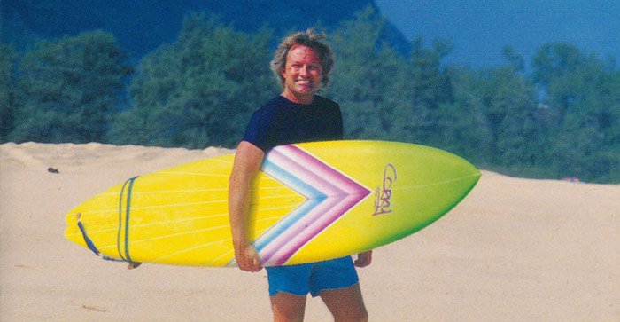 Corky Carroll Holding Surfboard