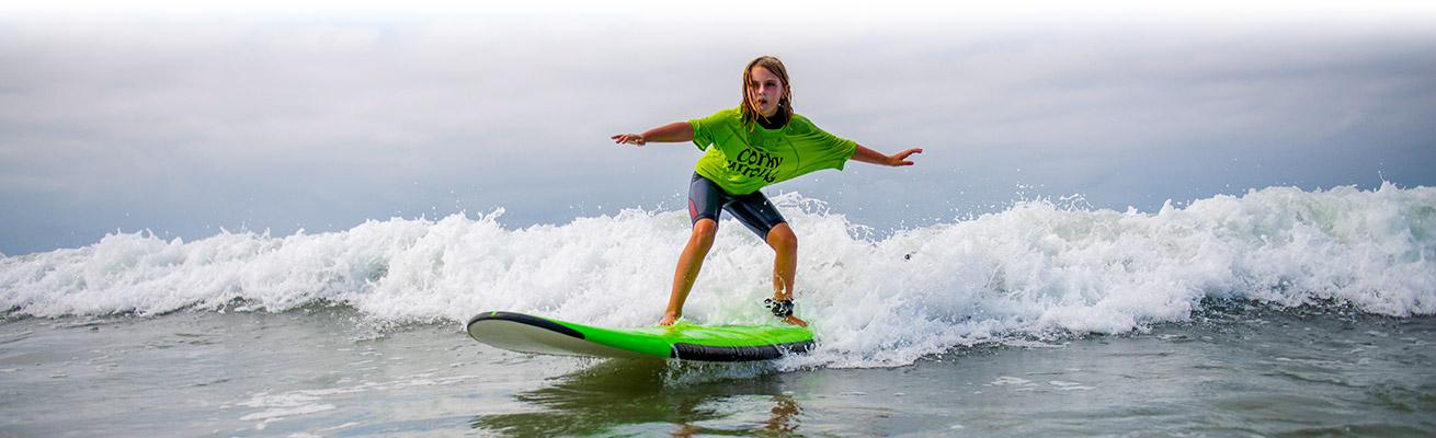 Camper Surfing Corky Carroll Surf School